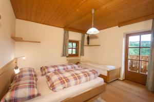 Schlafzimmer in Ferienwohnung in Seis am Schlern